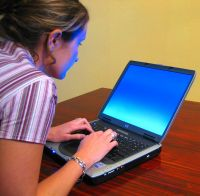 Woman-typing-on-laptop2